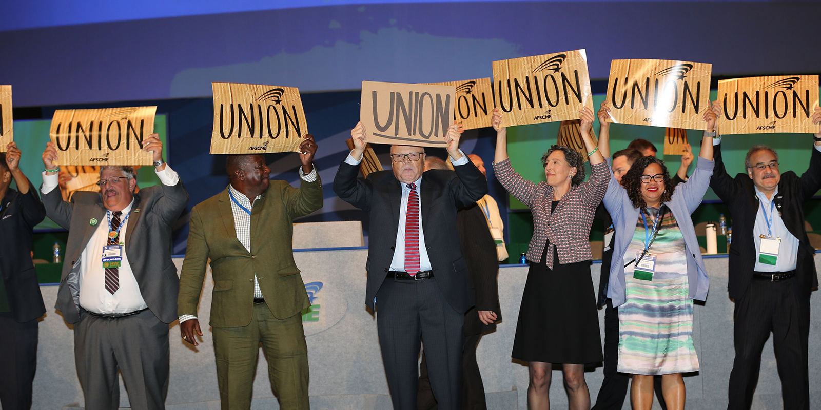 Lee Saunders, Elissa McBride and other union members hold up Union signs